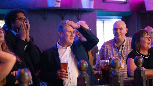 Labour Party leader Sir Keir Starmer watches the Arsenal v Tottenham Hotspur match at The Font pub in Brighton