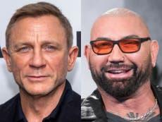 Daniel Craig recalls running away after breaking Dave Bautista's nose during filming