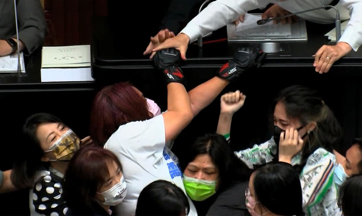 Taiwan lawmakers break out into brawl during policy speech