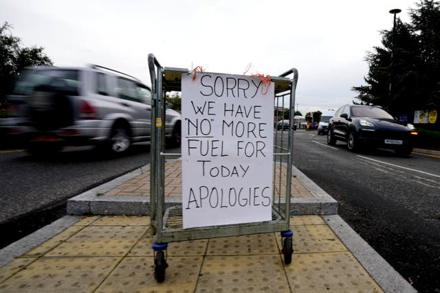 A sign referring to the lack of fuel is placed at the entrance to a petrol station in London