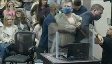 Scuffle breaks out at tense school board meeting on masks