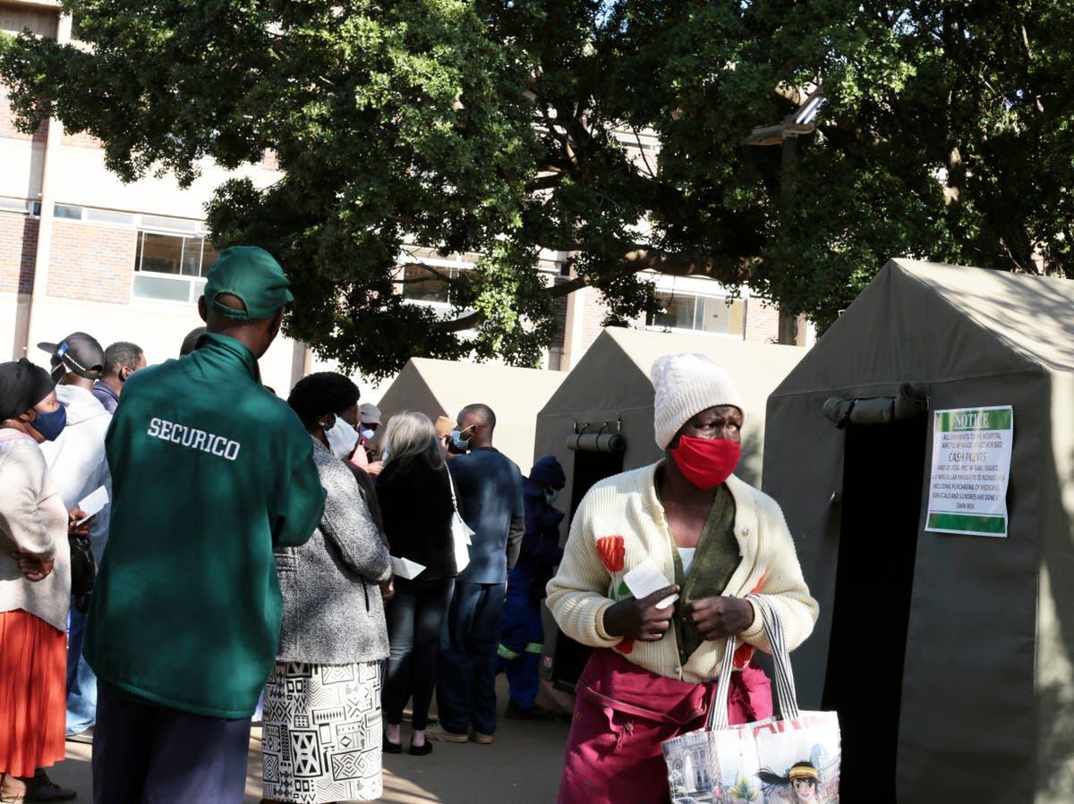Zimbabwe's vaccine mandates squeeze some of world's poorest