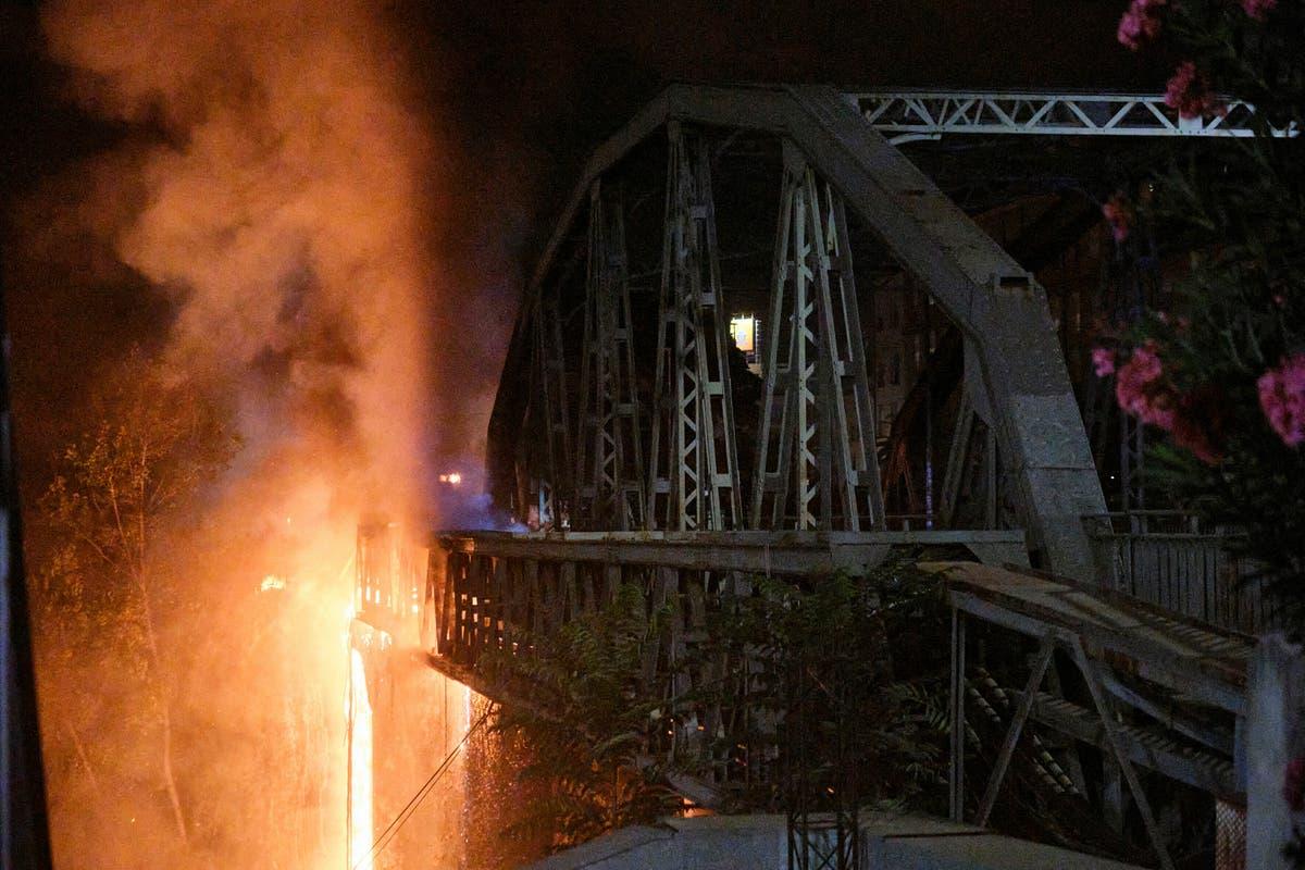 Blaze damages historic bridge spanning Tiber River in Rome