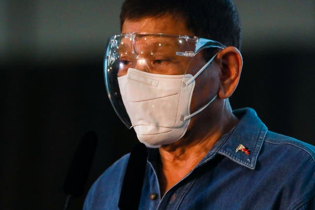 """Philippine President Rodrigo Duterte speaks to the media after Philippine Senator Christopher """"Bong"""" Go filed his certificate of candidacy to join the vice presidential race, at Sofitel Harbor Garden Tent, in Pasay City, Metro Manila"""