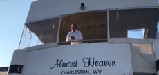 Joe Manchin leans over deck of his yacht to tell protesters why he'll oppose funding healthcare expansion