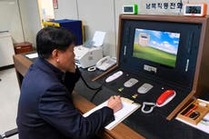 North and South Korea restore communications hotline despite missile test tension