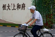 Evergrande shares suspended in Hong Kong amid acquisition rumours