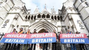 Members of 'Insulate Britain' outside the Royal Courts of Justice in London, before a hearing over the injunction banning the environmental activists from blocking the M25
