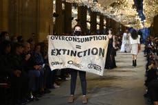 Climate change protestor crashes Louis Vuitton show at Paris Fashion Week