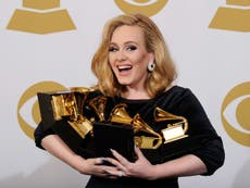 Adele says her new album is to help explain her divorce to her son