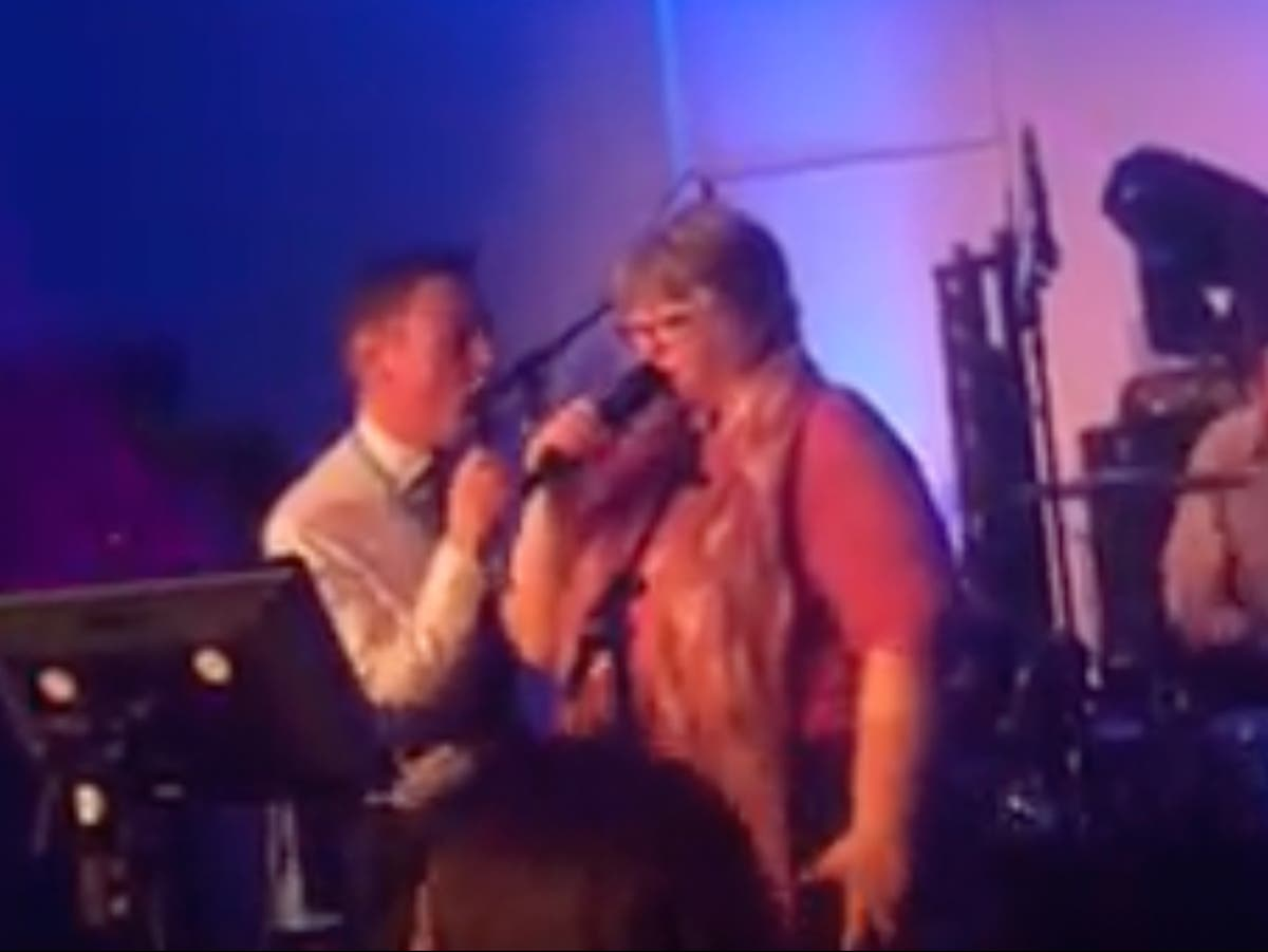 Tory minister sings about 'having time of my life' hour after universal credit cut