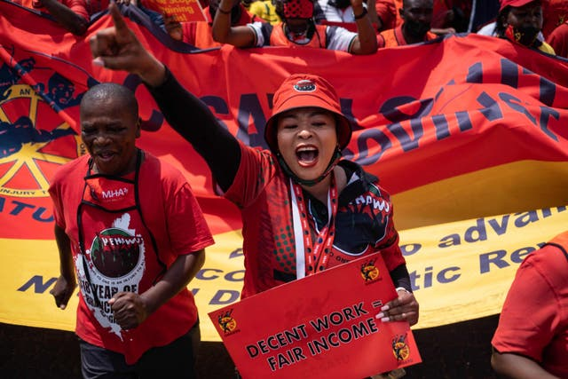 Supporters of the Congress of South African Trade Unions sing and dance at the National stayaway protest at the Fitzgerald square in Johannesburg to protest the economic policies, wages, as well as high unemployment rates in the country