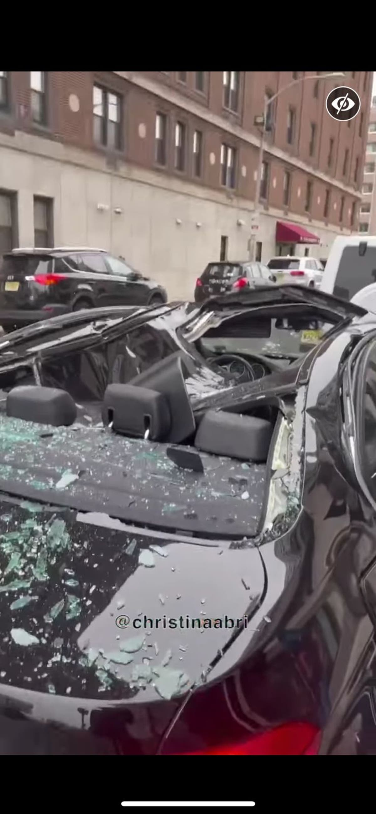 Man survives fall from ninth storey of high rise, lands on BMW's sunroof