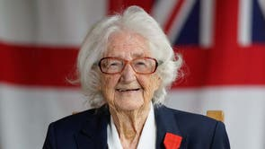 WW II veteran, 96-year-old Lorna Cockayne, who served in the Women's Royal Naval Service (WRNS), popularly and officially known as the Wrens, as a Bletchley Park codebreaker, poses for a photograph with the Legion d'honneur after receiving it during a ceremony at the Pear at Parley in Ferndown, Bournemouth