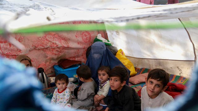 Afghan children who were displaced from other parts of the country live in temporary shelters at a camp in Kabul, Afghanistan,