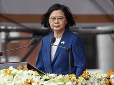 Taiwan president vows to defend island as China intensifies reunification pressure