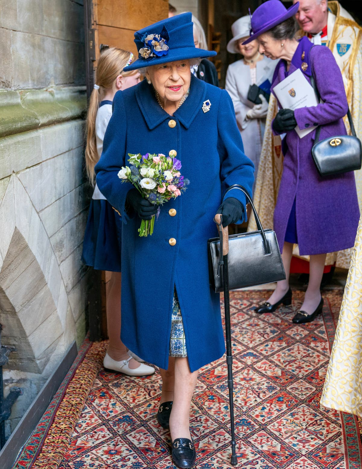Queen Elizabeth II uses cane to walk into Westminster Abbey