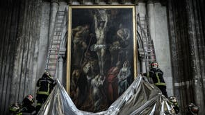 French firefighters protect a painting during a fire drill inside  Saint-Andre cathedral