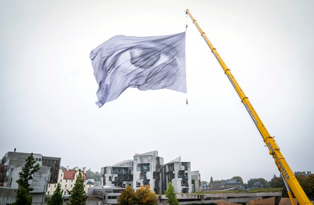 The aerial climate installation by Swiss artivist Dan Acher 'We Are Watching' is unveiled at Our Dynamic Earth in Edinburgh