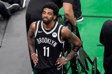 Kyrie Irving skips the jab and benches himself -- for now