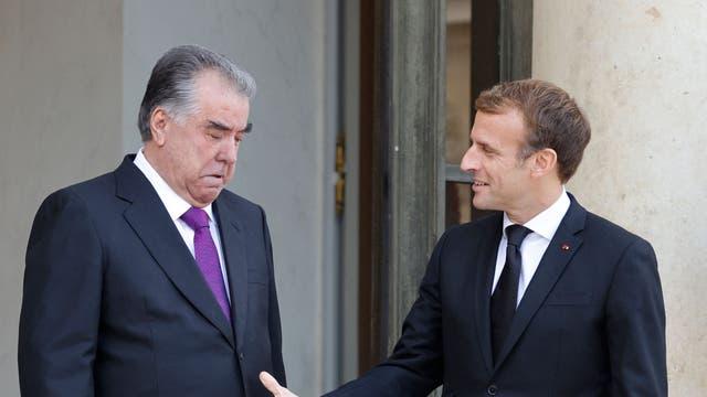 French President Emmanuel Macron (R) greets President of Tajikistan Emomali Rahmon at The Elysee Presidential Palace in Paris