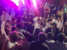 School apologises as students filmed kneeling in Spanish song