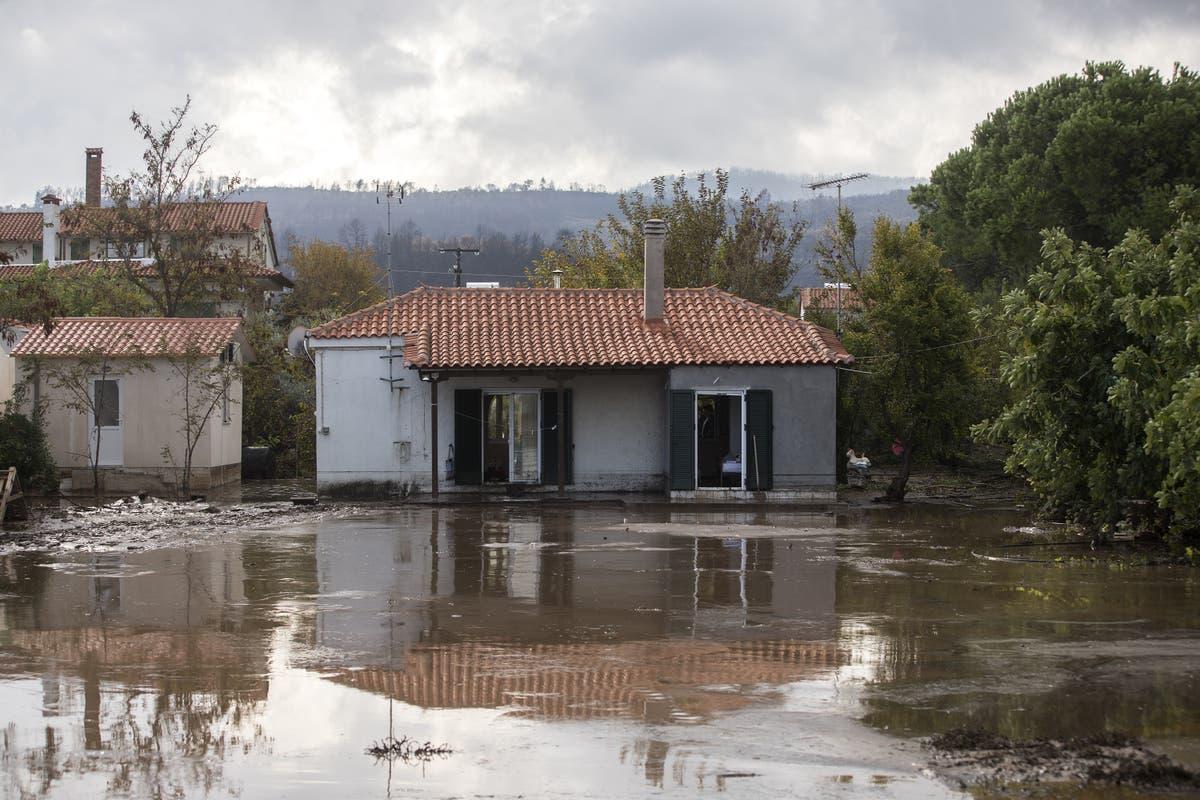 Storm batters fire-hit Greek island, evacuations ordered