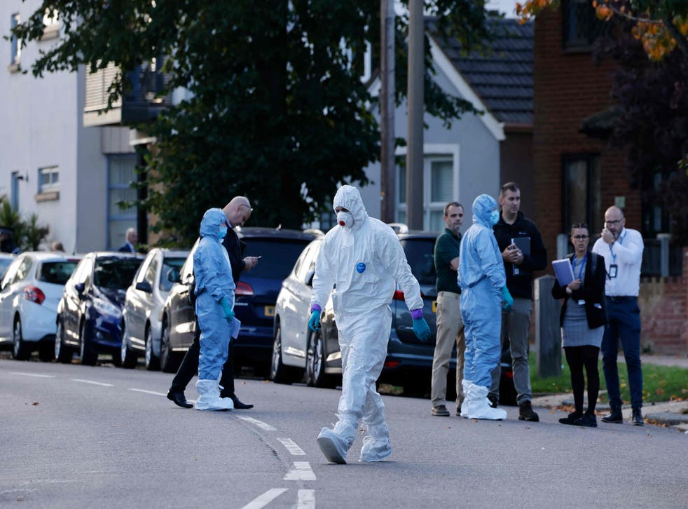 <p>A police forensics officer works at the scene</p>