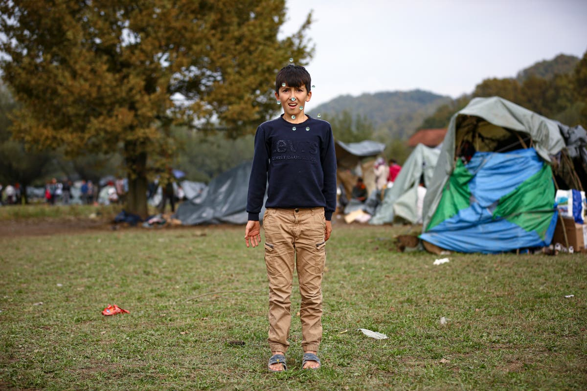 AP PHOTOS: Children brave the cold in makeshift Bosnian camp