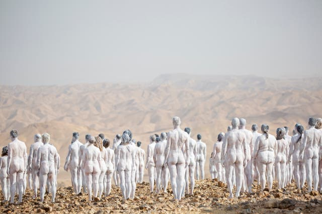 People pose nude for American artist Spencer Tunick as part of an installation in the desert near the Dead Sea, in Arad, Israel