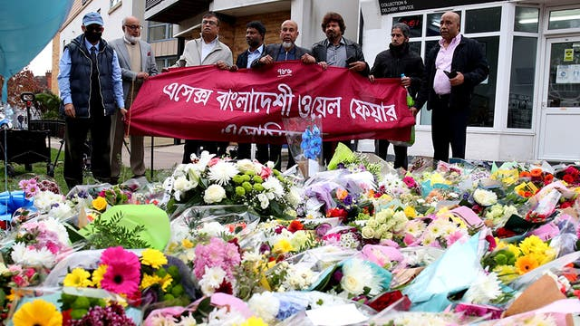 Members of the Essex Bangladeshi Welfare Association pay their respects by floral tributes laid at the scene where Sir David Amess MP was killed at Belfairs Methodist Church, in Leigh-on-Sea