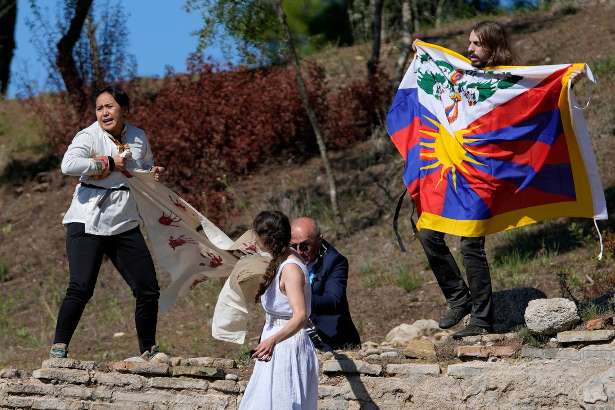 Protestors attempt to disrupt Olympic flame lighting