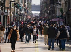 Mexico City lowers pandemic alert to lowest level