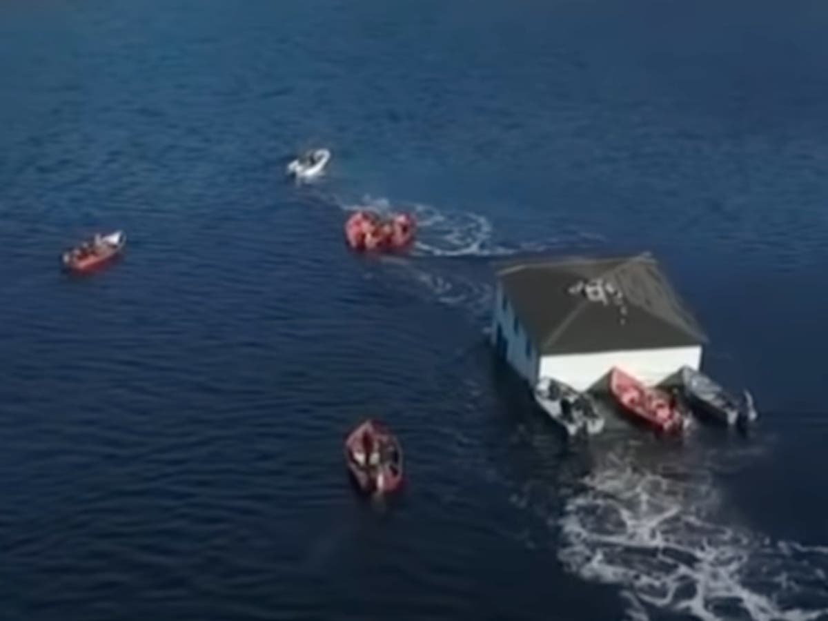 Video shows Canadian couple floating their 100-year-old dream house to new location