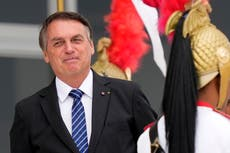 Report to urge charges against Brazil's leader over pandemic