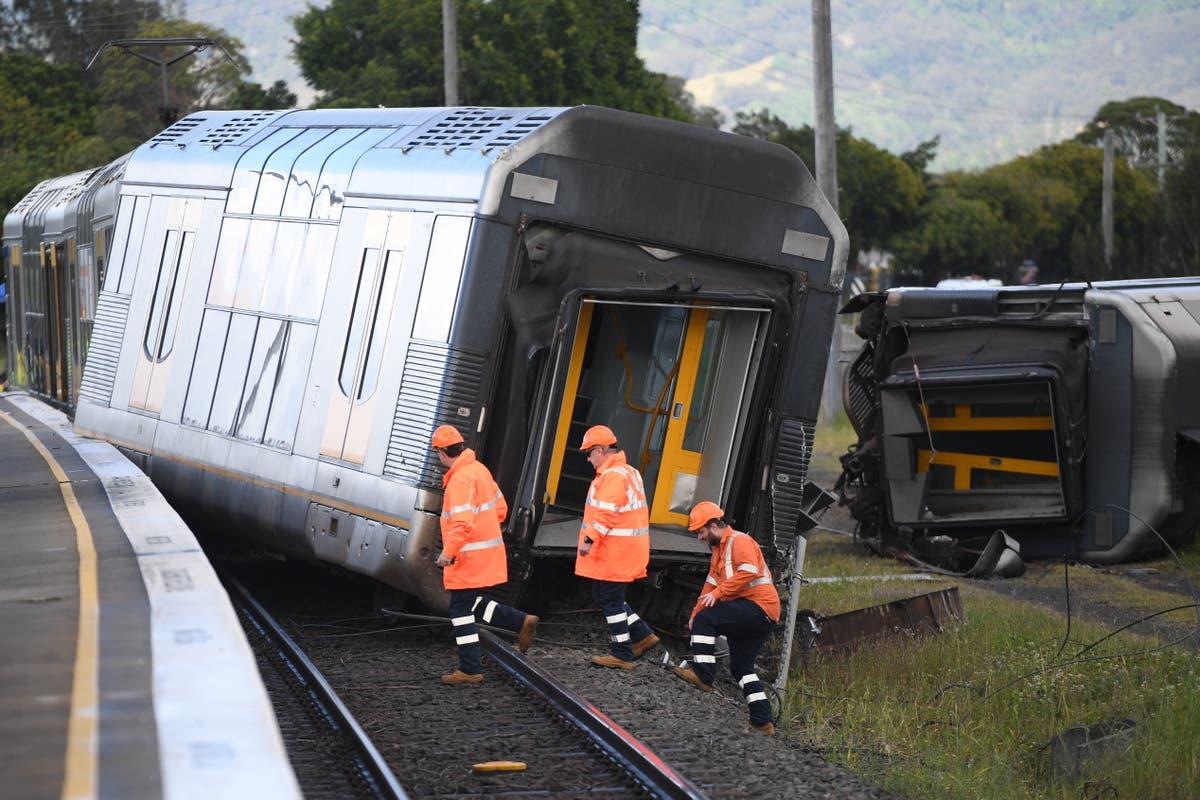 Australian passenger train derails in Sydney after hitting van on crossing
