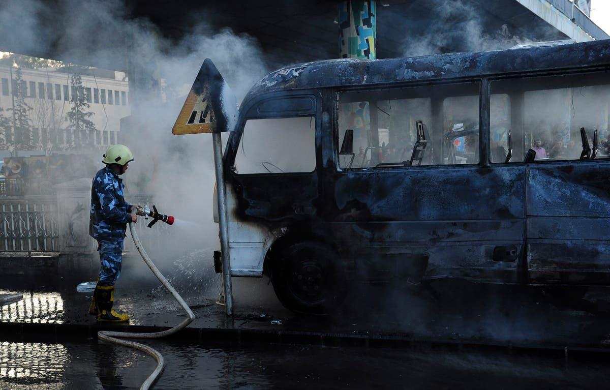 Roadside bombs hit military bus in Syrian capital, kill 14