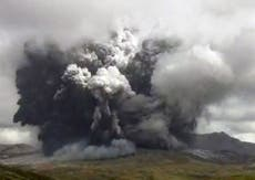 Volcanic eruption in Japan's Mount Aso spews ash and smoke miles into the sky
