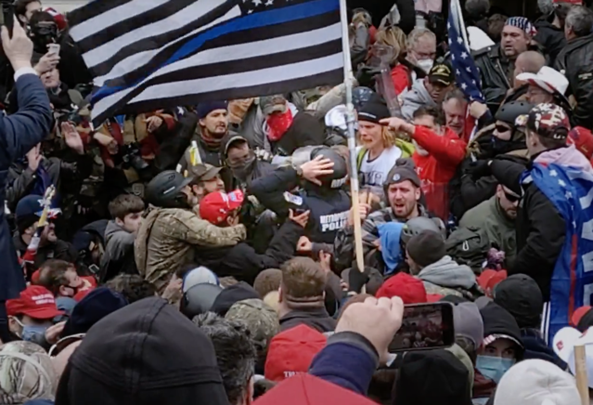Video shows pro-Trump rioters beating police officer under 'Blue Lives Matter' flag