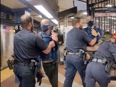 Unmasked NYPD officers push passenger out of subway after being asked to cover faces