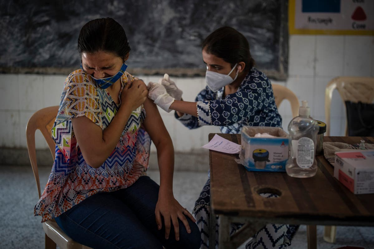 India hits 1B vaccine doses, worries about gap between shots
