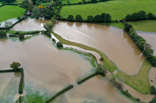 Flooded fields near Lingfield in Surrey, after southern England was hit overnight by heavy rain and strong winds from Storm Aurore moving in from France