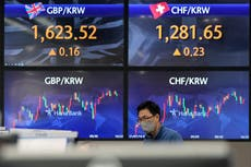 Asian shares mixed after S&Bl 500 squeaks to new record high