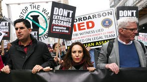 Partner of WikiLeaks founder Julian Assange, Stella Morris and Editor in Chief of WikiLeaks Kristinn Hrafnsson attend a protest ahead of the appeal hearing over Assange's extradition, in London