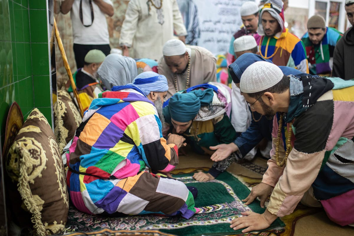 AP PHOTOS: Sufi religious order finally able to gather again