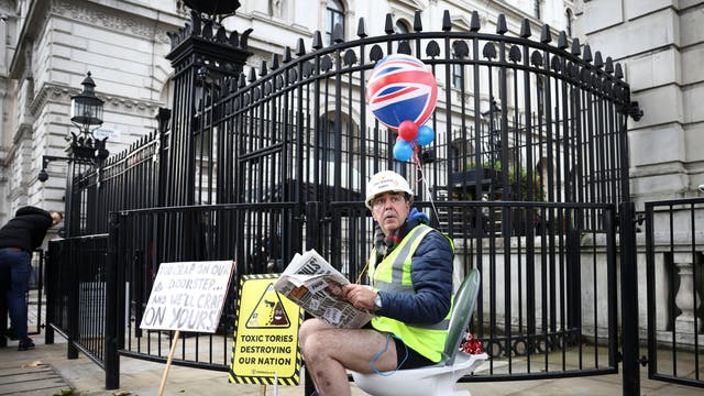 Activist Steve Bray demonstrates with a toilet outside the gates of Downing Street, after MPs voted in Parliament against the Environment Bill, allowing companies to pump raw sewage into UK rivers and seas,  in London