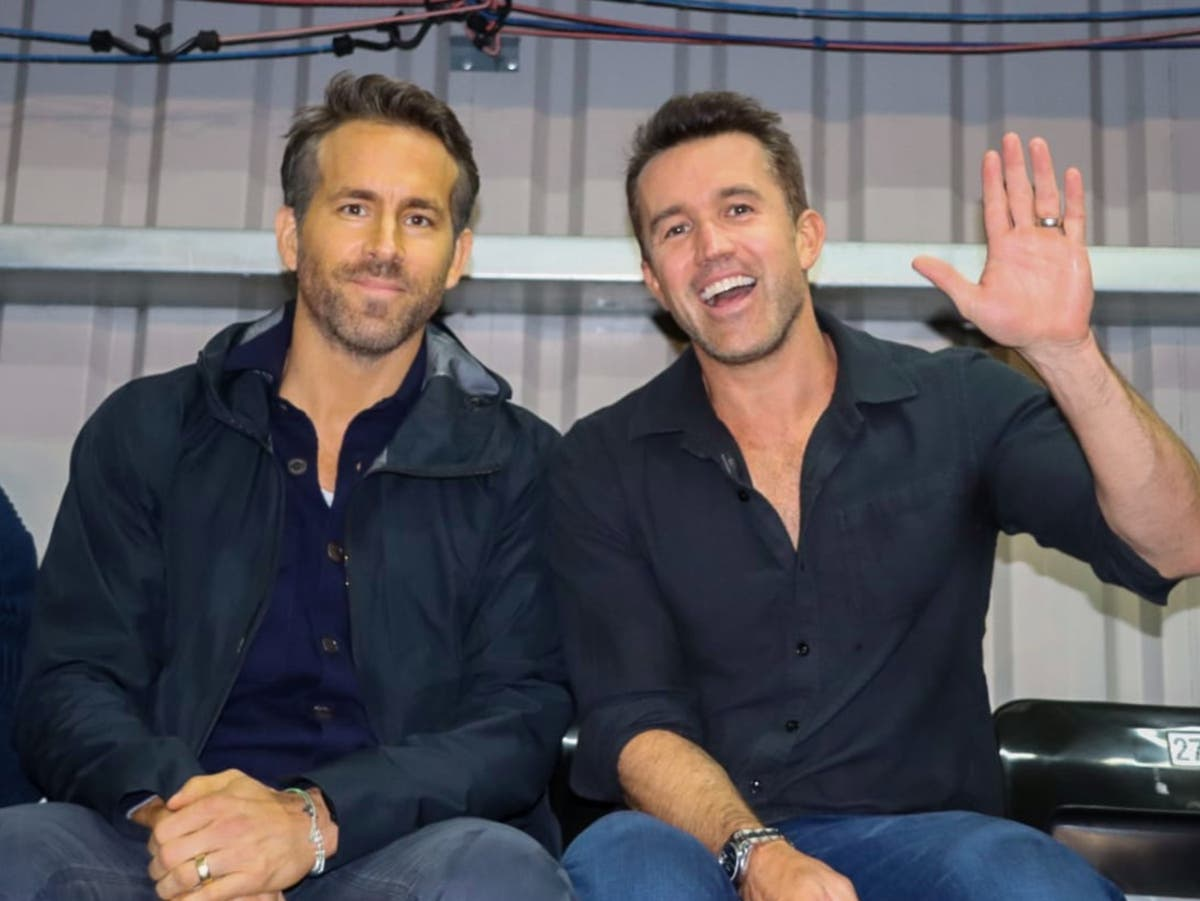 Co-owners Rob McElhenney and Ryan Reynolds attend Wrexham defeat