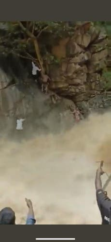 Mother and child rescued from raging waterfall in India