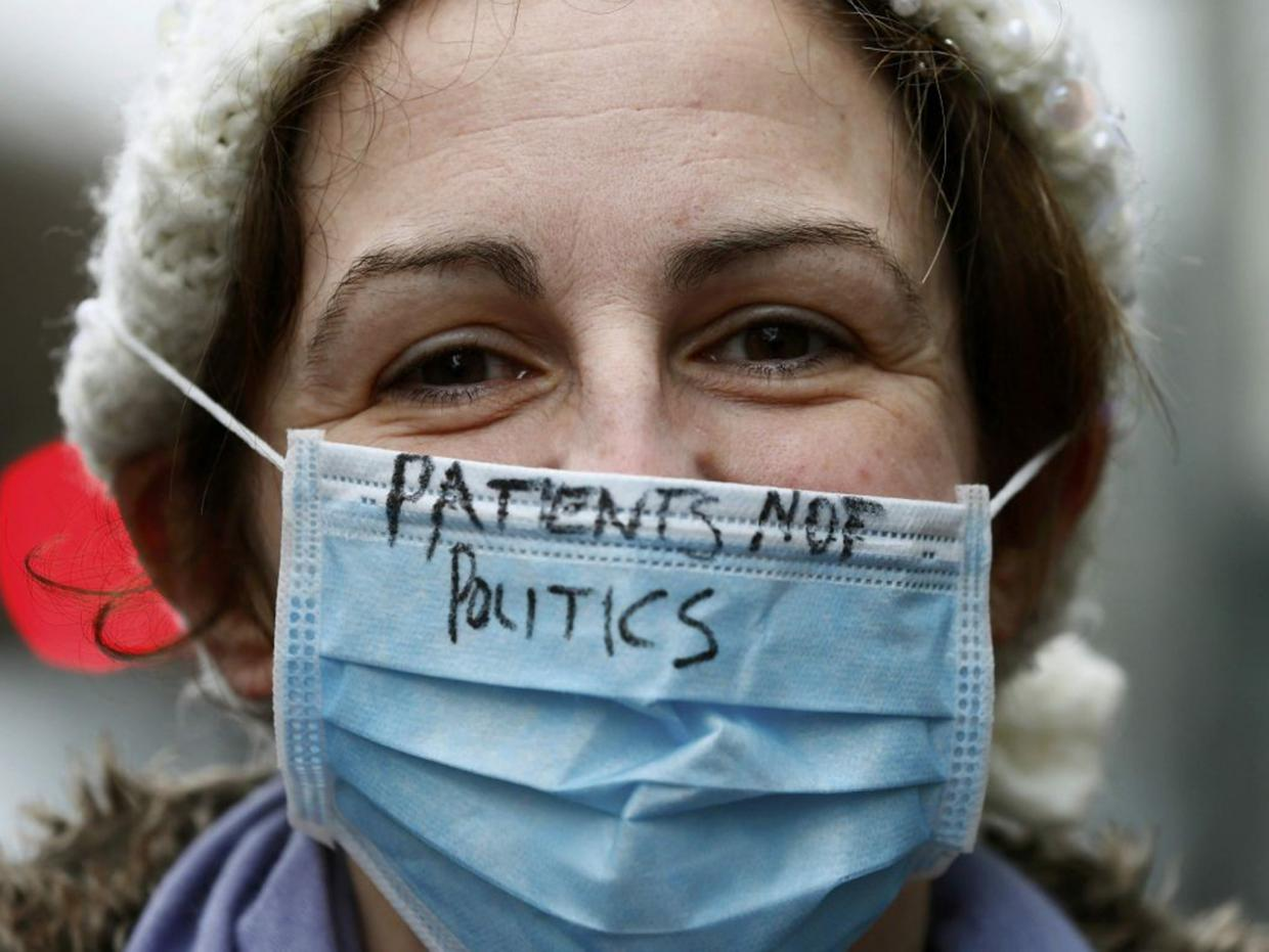 A junior doctor on strike outside University College Hospital, London. Stefan Wermuth Reuters