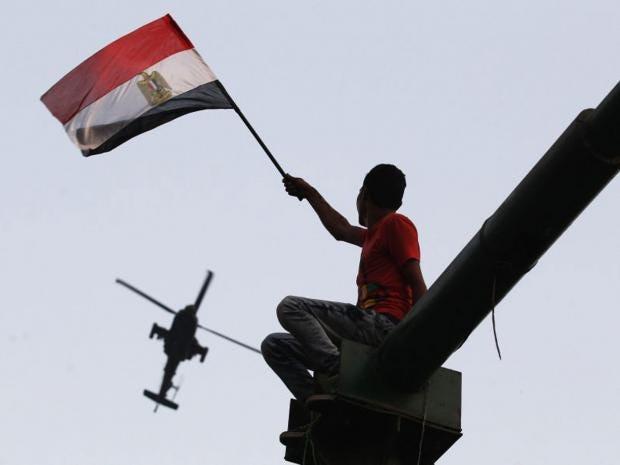 24-EgyptianFlag-Reuters.jpg